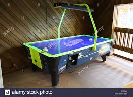 air hockey table hotel game room stock photo royalty free image