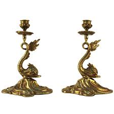 art deco dolphin ring holder images Pair of brass dolphin candlestick holders nyshowplace jpg