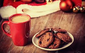 cookies and cup of coffee with christmas gifts stock photo