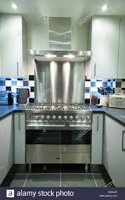 a modern gas electric range cooker with extractor and splashback
