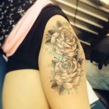black and white thigh tattoos