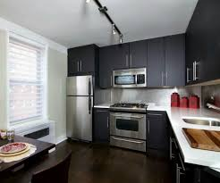 simple kitchen area with black painted plywood kitchen cabinet by