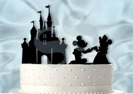 mickey and minnie proposing at the castle wedding cake topper