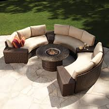 modern outdoor wicker circular patio sectional with stone top fire