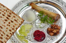 passover plate foods matzo bread next to passover seder plate with the seventh symbolic