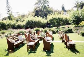 outdoor wedding decoration wooden benches garden grass green tree