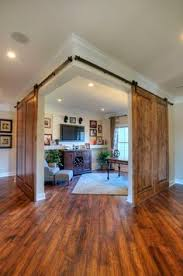 glass basement doors adding the barn door at the bottom of the staircase is a great