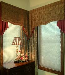 swag valance and jabot with drapery panels in master bedroom