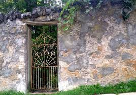 garden walls stone stone garden wall with ornate iron gate stock photo picture and