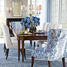 blue dining room chairs like the pop of color at the ends of table color also