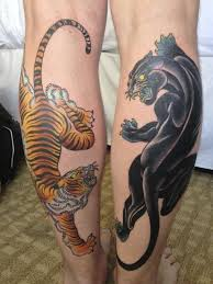 picture of tiger and panther tattoos on the both legs