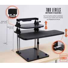 Standup Desk Standing On An Inflateable Denial Single Column Crank Adjustable