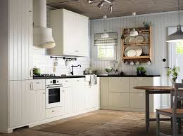 kitchens with white cabinets and wood floors white stone surround