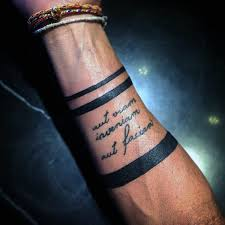 solid black mens armband tattoo with quote cursive lettering