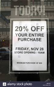 a sale sign on a store in new york on thanksgiving thursday