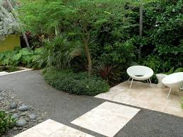 loose gravel landscape contemporary with shrubs resin landscaping