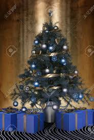 beautiful blue themeds tree decorated with baubles and