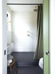 small bathroom with black hexagon floor tile and marblesubway