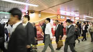 Tokyo Japan Circa November 2016 Crowds Of People Walking In Tokyo by Tokyo Japan Circa November 2016 People Walking In The Streets