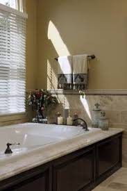bathroom tub decorating ideas decorating around a bathtub the happier homemaker home