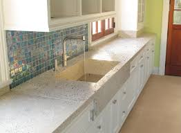beautiful kitchen with concrete counters and sink and abalone