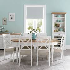 Dining Room Table With Wine Rack Soft Light Blue Wall Paint Minimalist White Wooden Cupboard Sans