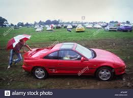 a toyota red toyota mr2 sports car parked in a street in england stock