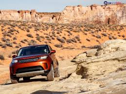 orange land rover discovery land rover discovery
