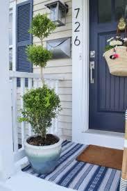 mailbox spr che metal barrels on front porch porch porch