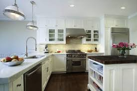 butcher block breakfast bar kitchen traditional with subway tiles