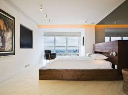 minimalist white bed frame with side tables in modern bedroom