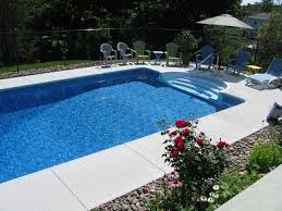 a picture of a rectangle inground swimming pool with grecian
