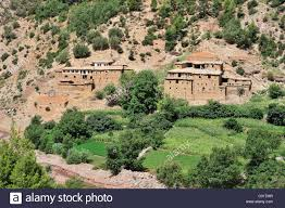 typical berber village with traditional adobe houses and small