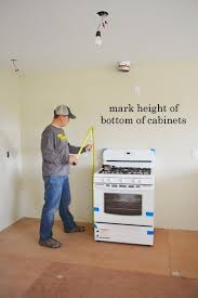 what height to hang cabinets installing kitchen cabinets momplex vanilla kitchen