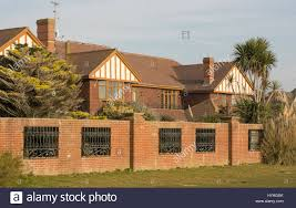 large house or mansion behind brick wall on the seafront and beach