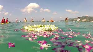 surfing thailand remembers the 2004 tsunami victims with a paddle