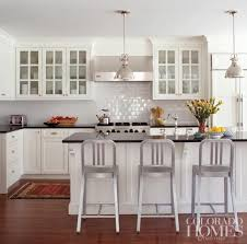 Colorful Kitchen Backsplashes White Subway Tile Backsplashes And Honed Black Granite Countertops