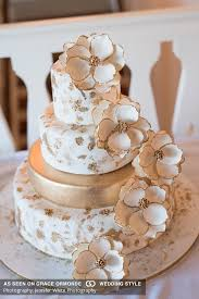 and white wedding gold and white wedding cake with cascading sugar florals cake