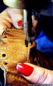woman with the golden gloves baseball mitts restored to their