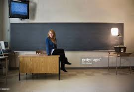 Sitting On The Desk Teen Sitting On Teachers Desk In Classroom Stock Photo