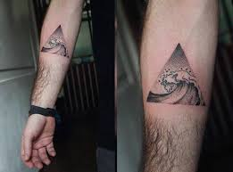 black turbulent sea in triangle tattoo on arms for men tatoo