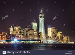 new york city skyline at night w the freedom tower under