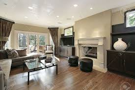 living room in luxury home with large fireplace stock photo