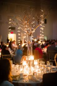 Vase And Candle Centerpieces by Tall Manzanita Branch Centerpiece With Hanging Orchids And Candles