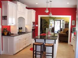 love this classic red kitchen that features bright white cabinets