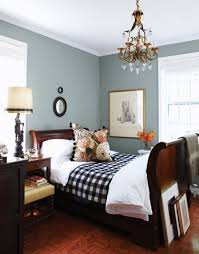 walnut sleigh bed blue walls vintage touches and buffalo check