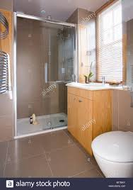 Modern Bathroom Doors Glass Doors On Large Walk In Shower In Modern Bathroom With Beige