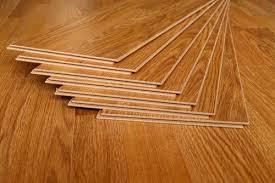 is vinyl flooring better than laminate vinyl vs laminate flooring pros cons comparisons and costs