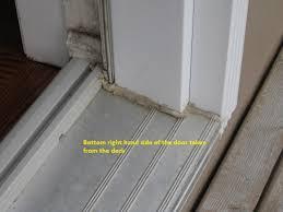 water leaking in through door on main floor down to basement