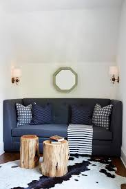 tree stump accent table dark blue tufted sofa with tree stump accent table and cowhide rug
